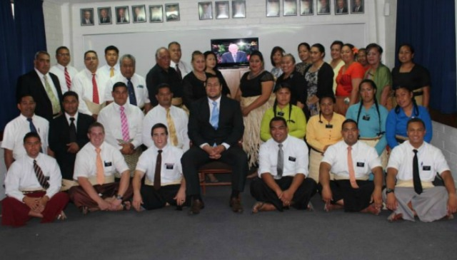 Prince Ata viewing the October 2014 General Conference with missionaries.